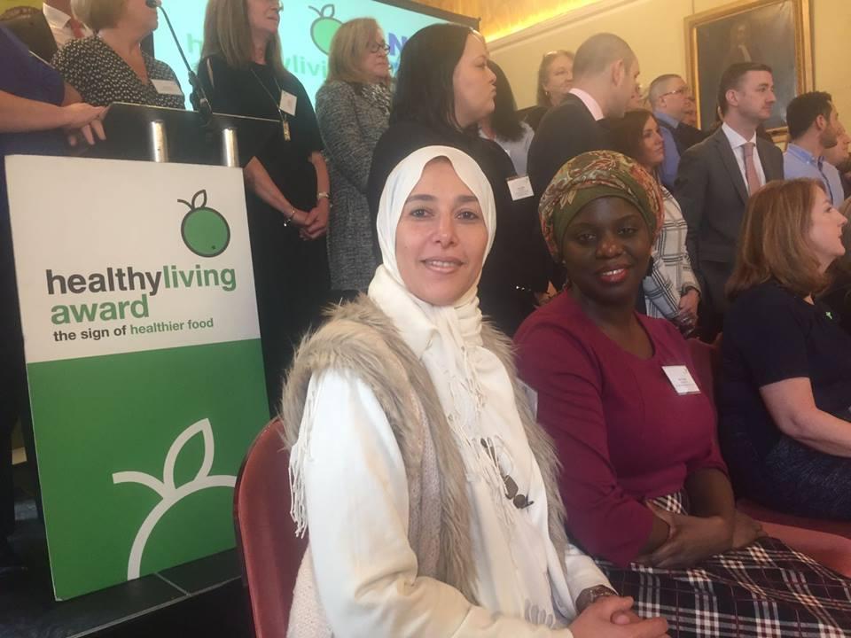 Balgeis and Diare receiving the Healthy Living Award