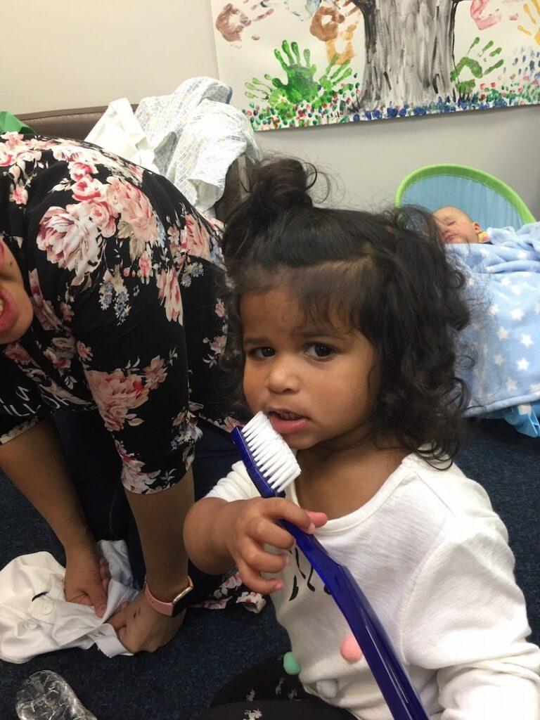 Little girl, big toothbrush